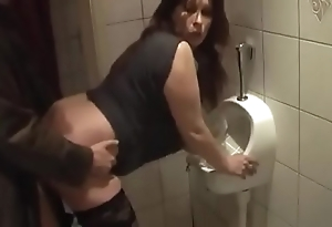 German milf succeed in pleasurable enjoyment stranger from young bloke beyond everything make an issue of the Gents